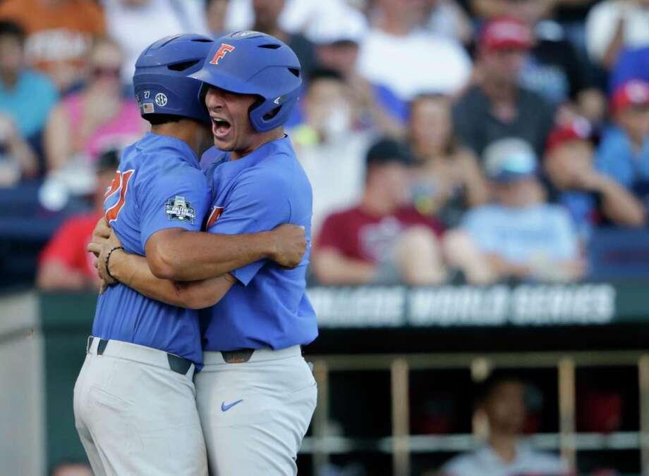 Florida's Nelson Maldon-ado, left, and Jonathan India embrace after scor-ing on a three-run home run by Deacon Liput. Photo: Nati Harnik, STF / Copyright 2017 The Associated Press. All rights reserved.