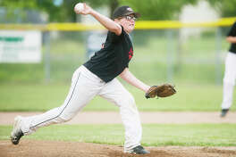 KATY KILDEE | kkildee@mdn.net Adam Brenske pitches the ball during his team's 12-2 loss to Ieuter Insurance during the major Little League city championship game on Tuesday in Midland.
