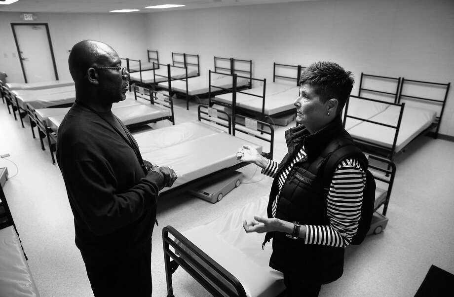 NAVIGATION COURSE: Dennis McCray, director of shelters with Episcopal Community Services, talks with nurse Marcy Fraser, who lives on Vermont Street where there is a troublesome encampment, during a tour of the new Dogpatch Navigation Center. Photo: Michael Macor, The Chronicle