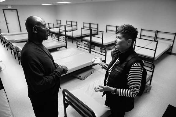 Dennis McCray, director of shelters with the Episcopal Community Services talks with Marcy Fraser during a tour of the new Navigation Center in the Dogpatch on Tuesday June 6, 2017, in San Francisco, Ca.