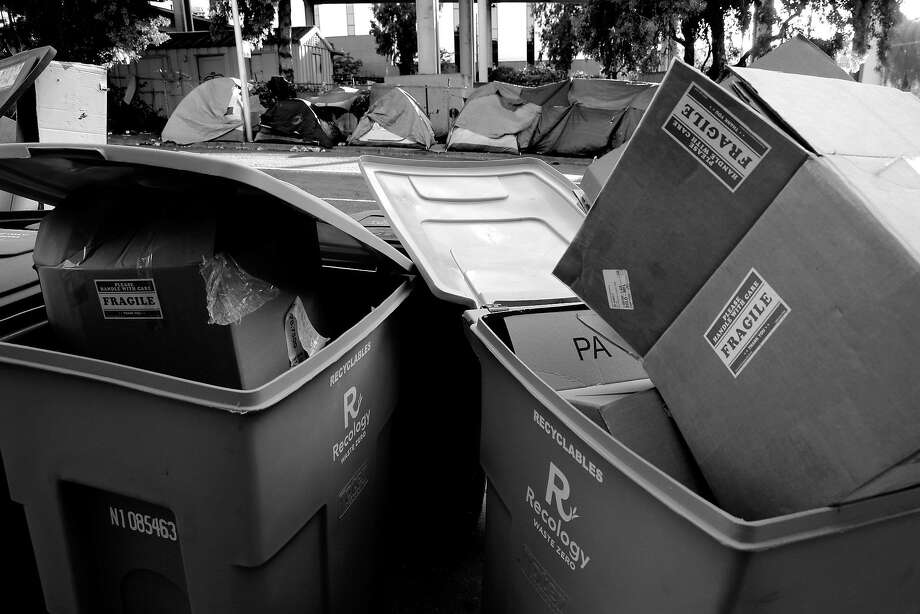 Recycling bins put out the night before for morning pickup along Vermont Street have become the targets of the homeless who camp nearby. They rummage through the cans at night looking for recyclables, creating a mess on the street and sidewalk. Photo: Michael Macor, The Chronicle
