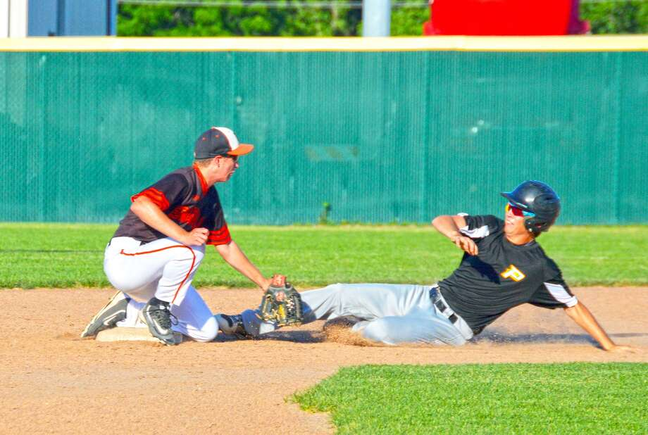Edwardsville second baseman David Grant, left, tags out a Piasa Southwestern runner trying to stretch a single into a double in the third inning.