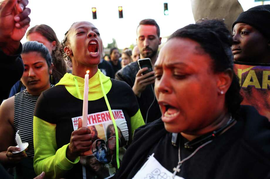 Tiffany Rogers and Florida Caroll, family members of Charleena Lyles, shout at police as hundreds marched from Magnuson Park to the Montlake Bridge after a vigil, Tuesday, in honor of Lyles, who was fatally shot by police Sunday morning, June 20, 2017. Photo: GENNA MARTIN, SEATTLEPI.COM / SEATTLEPI.COM