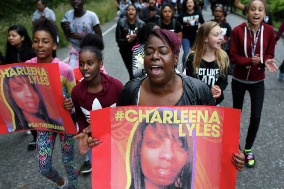 Family members of Charleena Lyles lead hundreds marching from Magnuson Park to the Montlake Bridge after a vigil, Tuesday, in honor of Lyles, who was fatally shot by police Sunday morning, June 20, 2017.