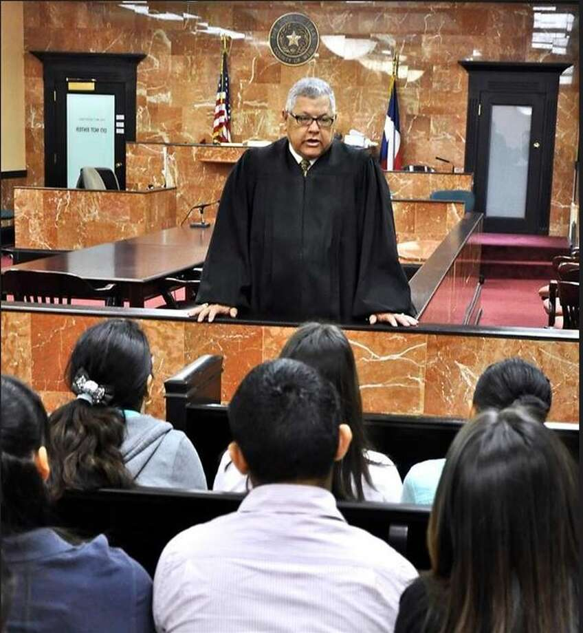 "Alvin ""Ben"" Morales, judge for the County Court at Law #1, talks to a group of students from Martin High School. Morales died Monday, June 19, Photo: Cuate Santos/Laredo Morning Times"