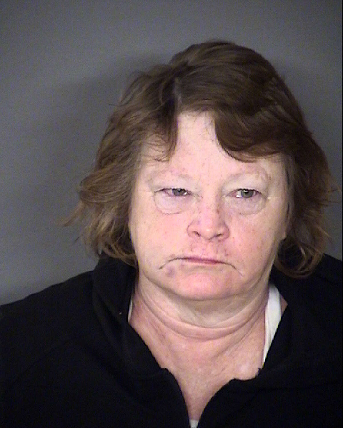 Evelyn Kay Garretson faces a charge of theft of an amount between $2,500 and $30,000. She remains in the Bexar County Jail.