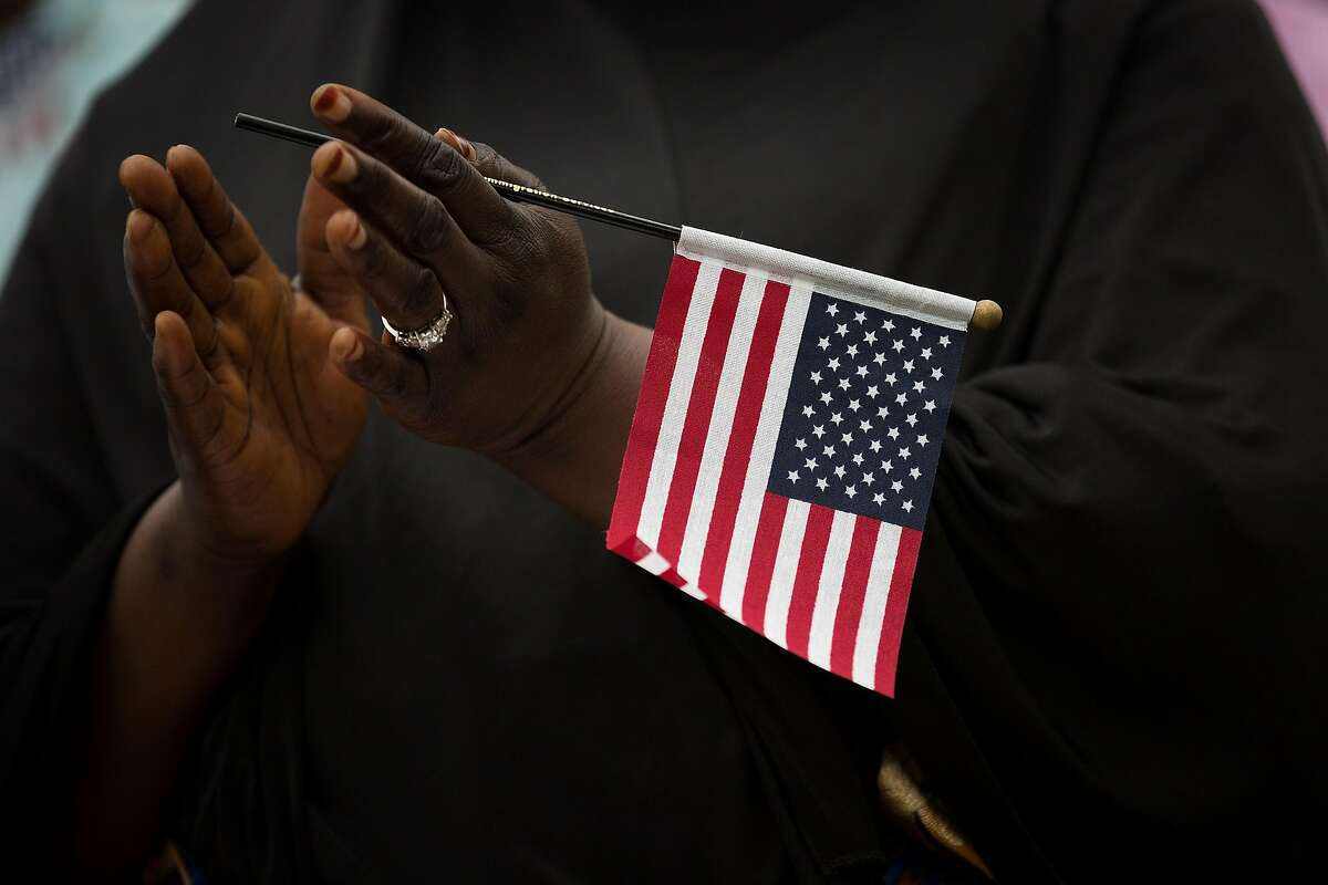 NEW YORK, NY - JUNE 16: Fatoumata Jangana of Gambia holds an American flag as she takes part in a naturalization ceremony at Franklin D. Roosevelt Four Freedoms Park on Roosevelt Island, June 16, 2017 in New York City. 50 citizenship candidates became U.S. citizens at the conclusion of the ceremony. (Photo by Drew Angerer/Getty Images)