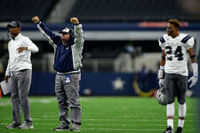 West Orange-Stark coach Cornel Thompson celebrates after a touchdown during the second quarter of the Class 4A-Division II state final against Sweetwater at AT&T Stadium in Dallas on Friday. Photo taken Friday 12/16/16 Ryan Pelham/The Enterprise