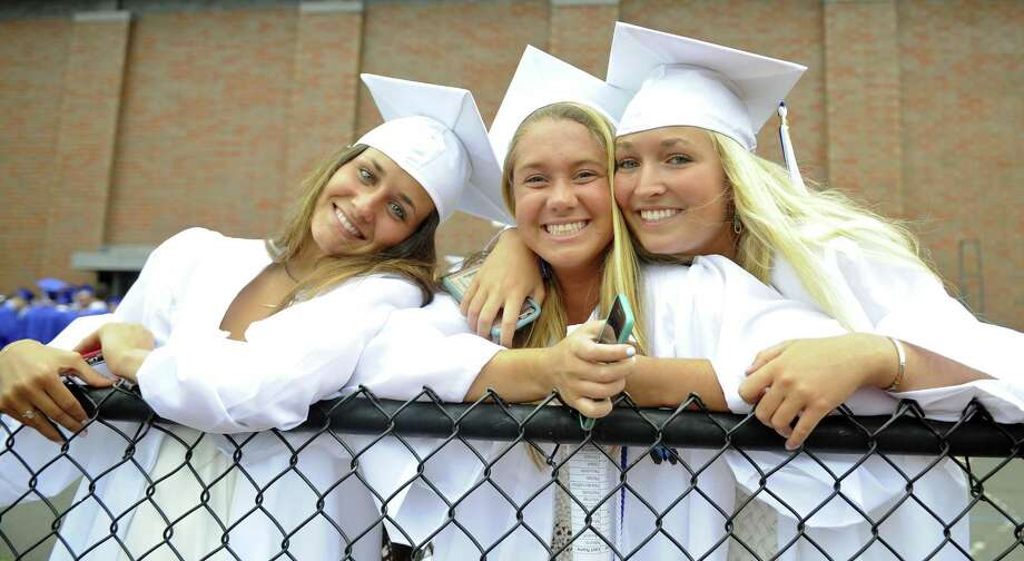 Elise Mercein, Kallie Coughlin and MorganMcLaren prior to the Darien High School Class of 2017 Commencement Exercises at the school on Friday. Photo: Matthew Brown / Hearst Connecticut Media / Stamford Advocate