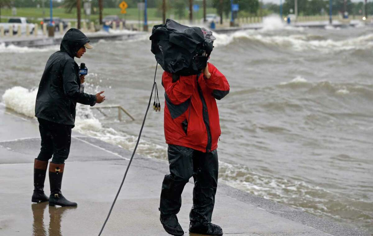 A television news crew reports from the shore of Lake Pontchartrain as weather from Tropical Storm Cindy, in the Gulf of Mexico, impacts the region in New Orleans, Tuesday, June 20, 2017.