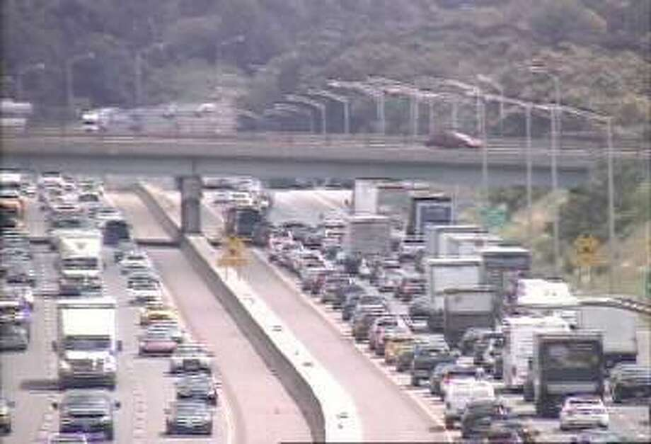 Traffic slows near a 3 car accident near Orange, Conn. Two lanes were reported closed before Exit 41, Northbound. Photo: Contributed Photo / CT DOT