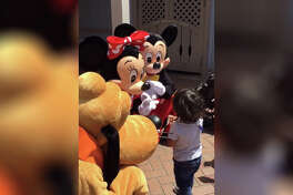 Mickey and Minnie surprise a deaf child by signing back to him at Disneyland.