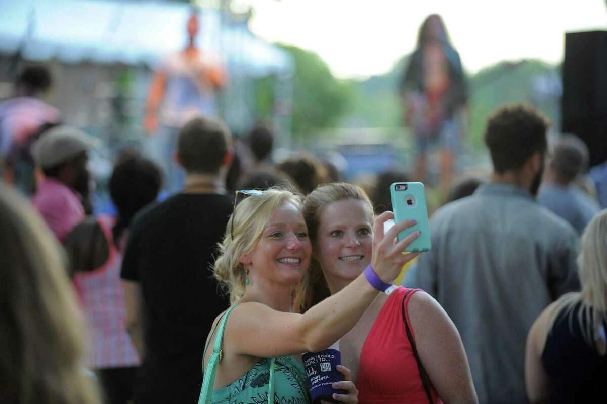 Janelle Einstein and Sarah Deliski, both of Stamford, take a selfie at an Alive@Five concert last summer at Columbus Park in Stamford.