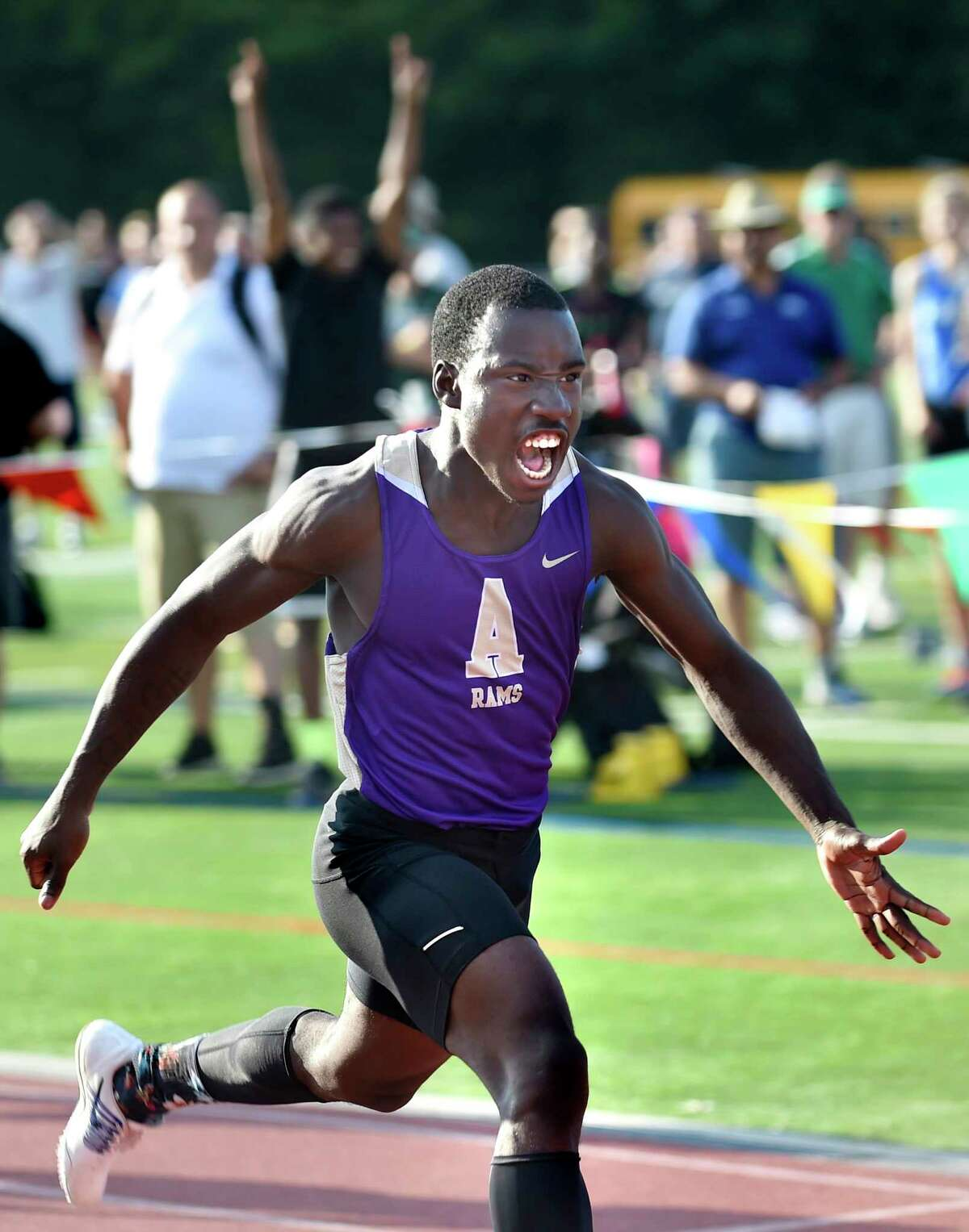 Amsterdam's Kevon Boucaud takes first in the Division I 100-meter dash and celebrates his 17th birthday during the state qualifier meet on Friday, June 3, 2016, at Shenendehowa High in Clifton Park, N.Y. (Cindy Schultz / Times Union)