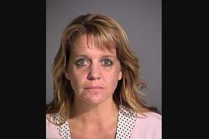 Shari Tremba and Michael Trosclair were arrested on charges of public intoxication and neglect of a dependent.