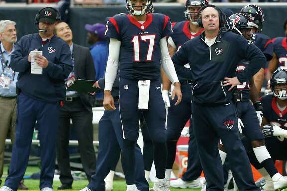 Houston Texans quarterback Brock Osweiler (17) stands with offensive coordinator George Godsey during the second quarter of an NFL football game against the San Diego Chargers at NRG Stadium on Sunday, Nov. 27, 2016, in Houston. ( Brett Coomer / Houston Chronicle )