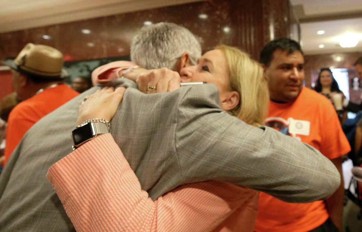District I Council Member Robert Gallegos, left, and Senator Sylvia Garcia after council members voted to join the lawsuit against Senate Bill 4 during a city council meeting at City Hall Wednesday, June 21, 2017, in Houston.