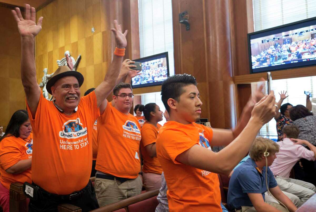 People with United We Dream celebrate after council members voted to join the lawsuit against SB4 during a City Council meeting at City Hall Wednesday, June 21, 2017, in Houston.