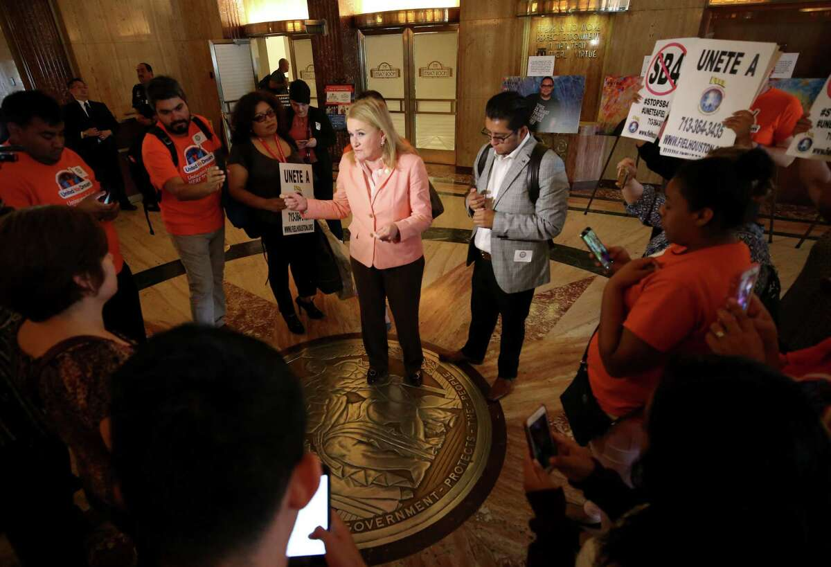 Senator Sylvia Garcia, center, talks to opponents of Senate Bill 4 after Houston council members voted to join the lawsuit against SB4 during a City Council meeting at City Hall Wednesday, June 21, 2017, in Houston.