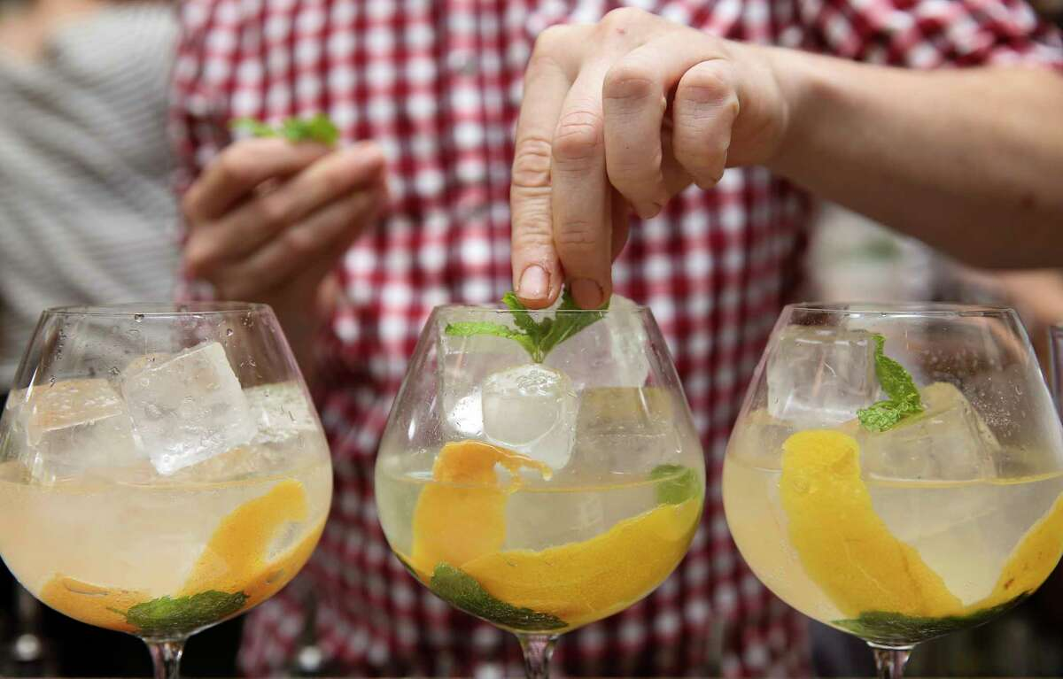 Coltivare bartender William Stewart makes three orders of gin and tonic, the most popular drink at the restaurant, at the bar Friday, June 9, 2017, in Houston. Parts of the Heights that still have alcohol sales restrictions are starting a petition to allow establishments to sell mixed drinks. ( Yi-Chin Lee / Houston Chronicle )