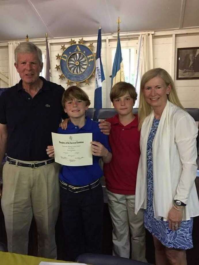 Connor's dad John (left), Connor, his twin brother, Mark, and mom, Christa, at his award luncheon in Windsor, Ct in May 2017. Photo: Contributed Photo / Contributed Photo / Darien News contributed
