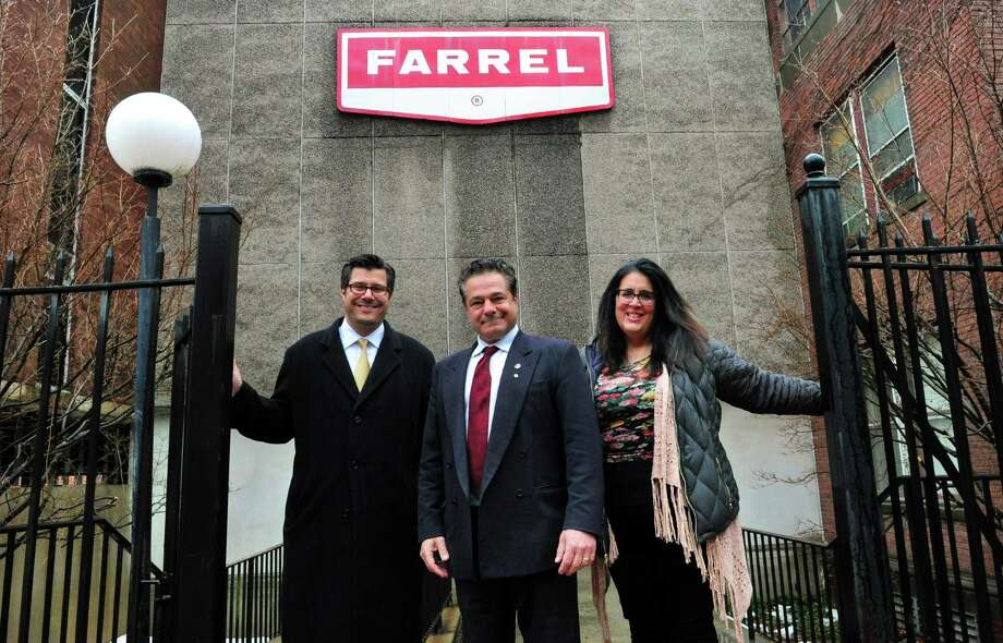 Corporation Counsel John Marini, left, Mayor David Cassetti and Economic Development Commission's Sheila O'Malley right, pose in front of the former Farrel Corporation's office building which will become the police department headquarters and house the senior citizen center Photo: Christian Abraham / Hearst Connecticut Media / Connecticut Post