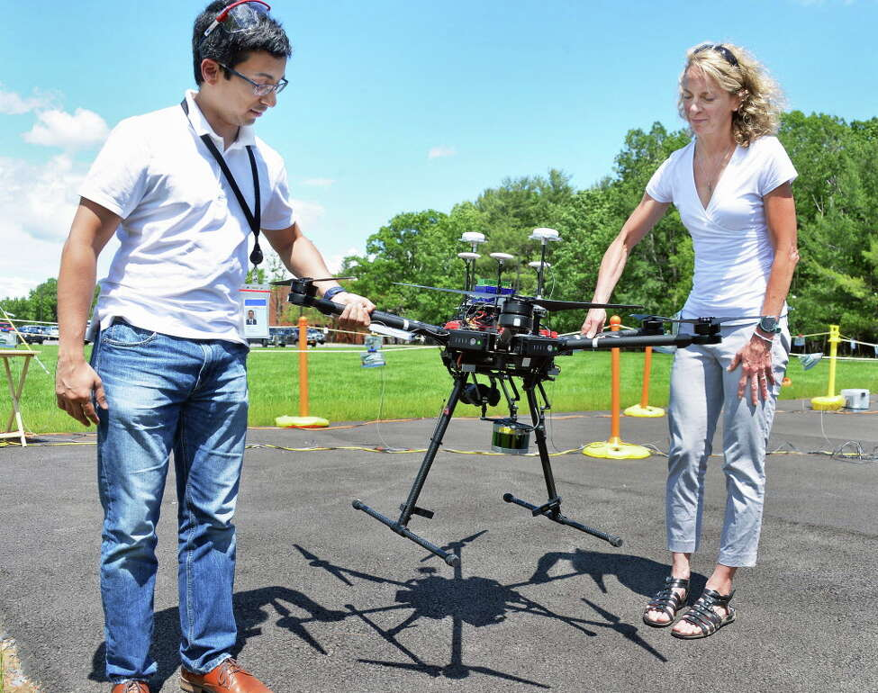 GE Global Research advanced robotics team members Shiraj Sen, left, and Judy Guzzo position their Euclid aerial inspection system autonomous drone for a test flight Tuesday June 20, 2017 in Niskayuna, NY. (John Carl D'Annibale / Times Union)