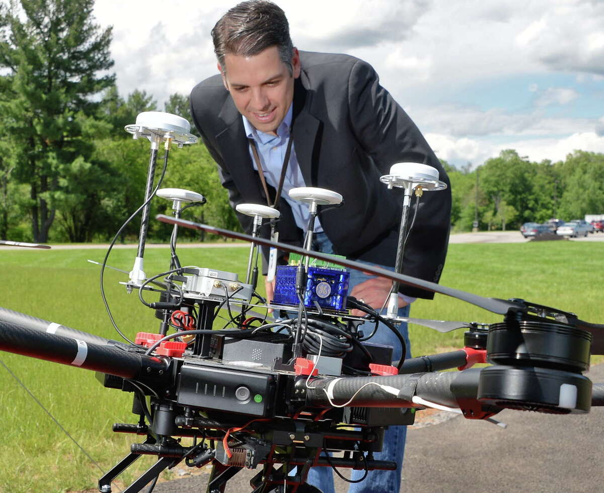 Director of robotics at GE Global Research looks over his team's Euclid aerial inspection system autonomous drone Tuesday June 20, 2017 in Niskayuna, NY. (John Carl D'Annibale / Times Union)