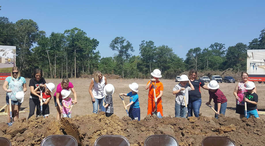 A group of children help break ground at the site of the new Huffman ISD school during a groundbreaking ceremony in Huffman on Tuesday, June 20. Photo: Melanie Feuk