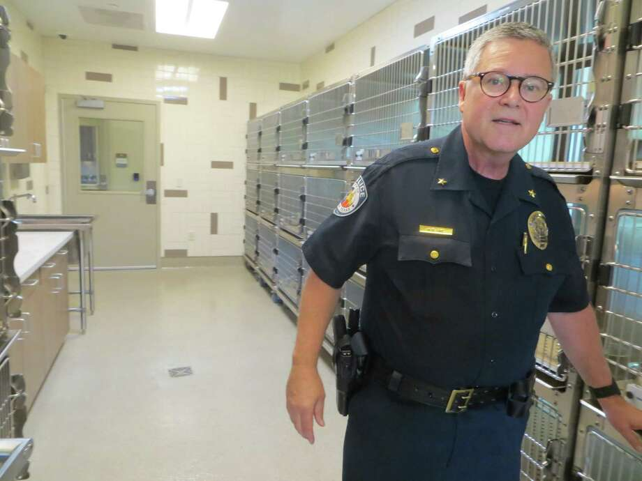 Seguin Deputy Police Chief Bruce Ure walks through the cat room at the city's new animal shelter, which opened earlier this year. Ure was injured Sunday night in the attack at a Las Vegas concert, where a gun man opened fire on the crowd from a room at the Mandalay hotel, killing more than 50 people and injuring more than 500. Despite his injury, Ure assisted with attending to the wounded at the concert. Photo: Zeke MacCormack /San Antonio Express-News