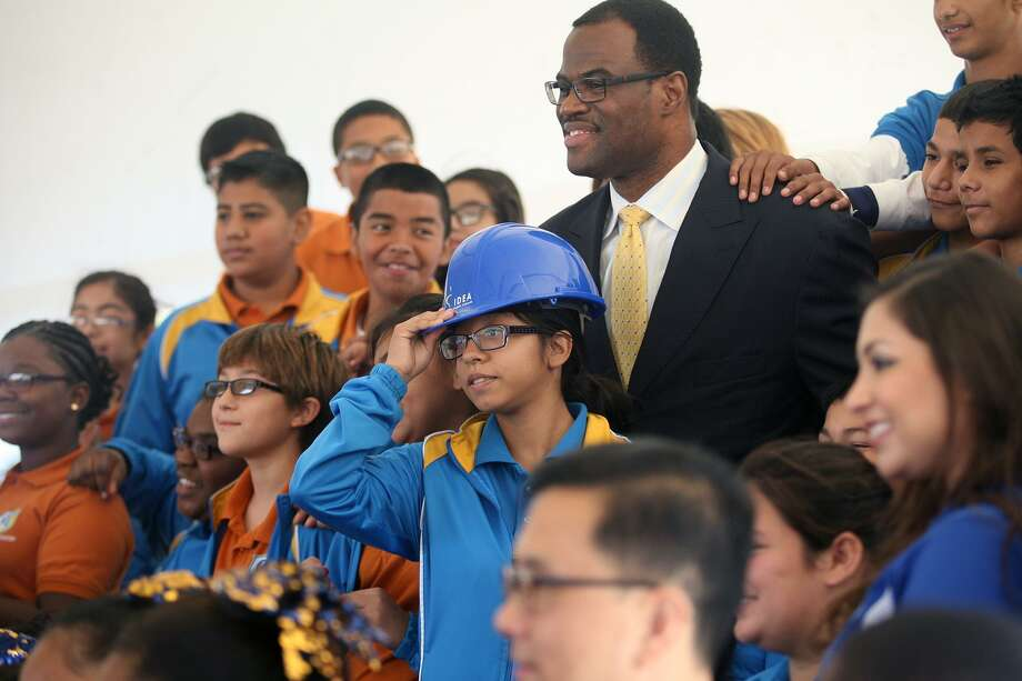 David Robinson takes photos with IDEA Carver Academy students including Yaletsi Guerrero who wore Robinson's hardhat Oct. 22, 2014 after the groundbreaking ceremony of IDEA Carver College Prep. Carver Academy was founded by Robinson in 2012 and the new school will include a David Robinson Museum. Photo: CYNTHIA ESPARZA /For The Express-News / San Antonio Express-News
