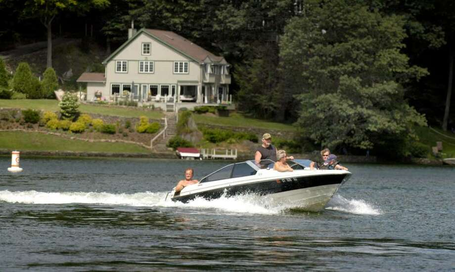Pictured are boaters on Candlewood Lake in Sherman last summer. Photo: File Photo / The News-Times File Photo