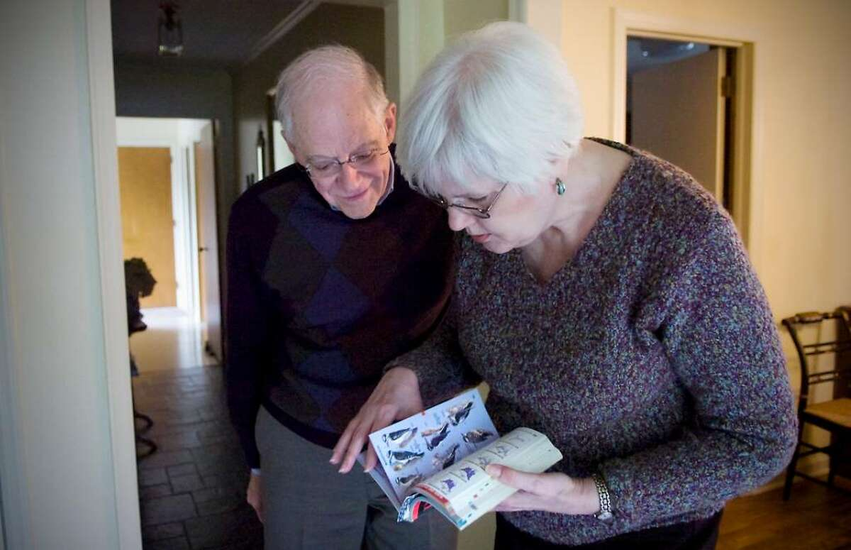 Peter and Ann Case flip through a bird book at their home in Stamford Conn. on Tuesday June 8, 2010.