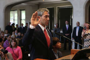 Ron Nirenberg (center, hand raised) is sworn in Wednesday June 21, 2017 as San Antonio's new mayor. Several new city council members were also sworn in at the event held at council chambers.