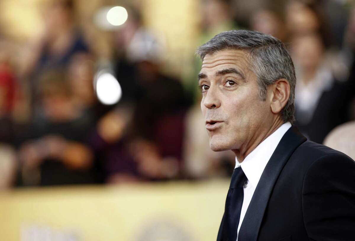 George Clooney in January 2012 in Los Angeles. On June 21, 2017, Diageo announced it would spend up to $1 billion for the Casamigos brand created by Clooney in 2013 alongside two partners. (AP Photo/Matt Sayles)
