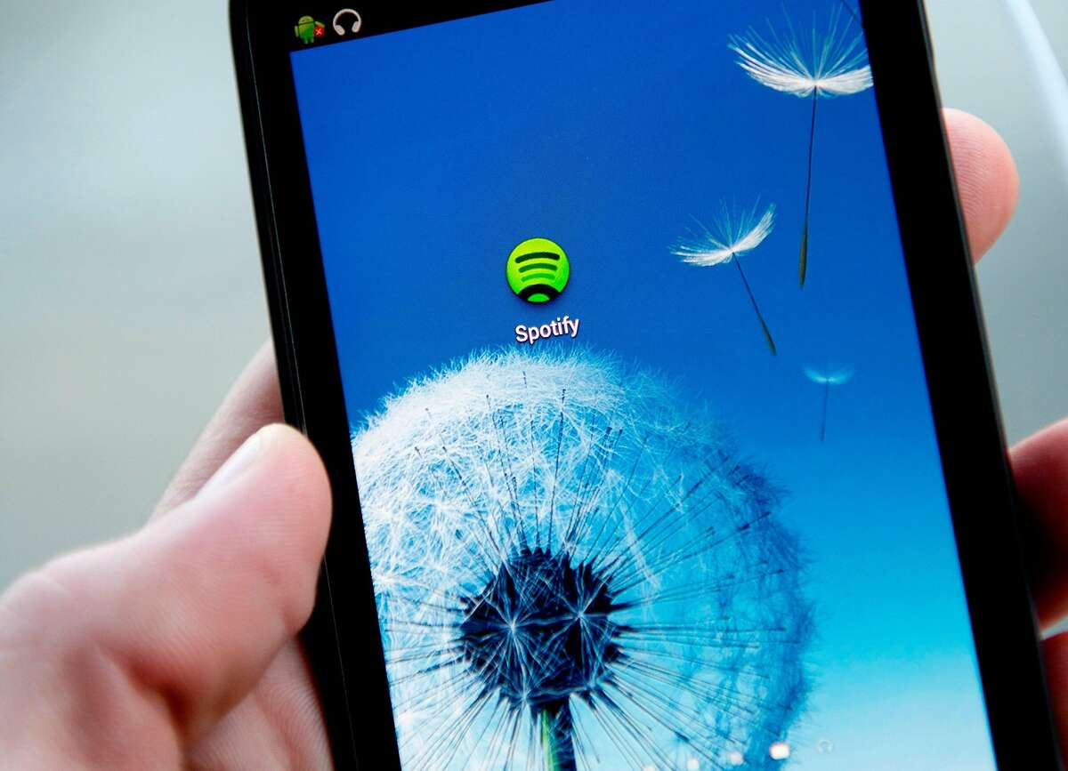 (FILES) This file photo taken on March 6, 2013 shows the Android application logo of Swedish music streaming service Spotify in Stockholm, Sweden. Music streaming leader Spotify has agreed to set up a $43.45 million fund to settle a potentially costly pair of US copyright lawsuits from artists, lawyers said May 29, 2017. The move marks the latest effort by the Swedish company to turn the page on messy disputes as it considers a public listing amid the soaring growth of streaming. / AFP PHOTO / JONATHAN NACKSTRANDJONATHAN NACKSTRAND/AFP/Getty Images