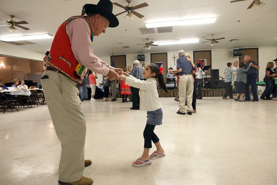 Ledislav Zezula, 79, dances with 4-year-old Grace Castro during the Bexar County Chapter of The Czech Heritage Society of Texas annual Czech Heritage Festival at Knights of Columbus on Rigsby Avenue, Oct. 21, 2012. Music by Chris Rybak, food, costumes, genealogy displays and a silent auction were part of the festival. Photo: Jerry Lara /San Antonio Express-News / © 2012 San Antonio Express-News