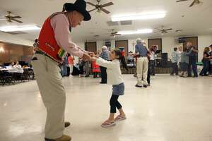Ledislav Zezula, 79, dances with 4-year-old Grace Castro during the Bexar County Chapter of The Czech Heritage Society of Texas annual Czech Heritage Festival at Knights of Columbus on Rigsby Avenue, Oct. 21, 2012. Music by Chris Rybak, food, costumes, genealogy displays and a silent auction were part of the festival.