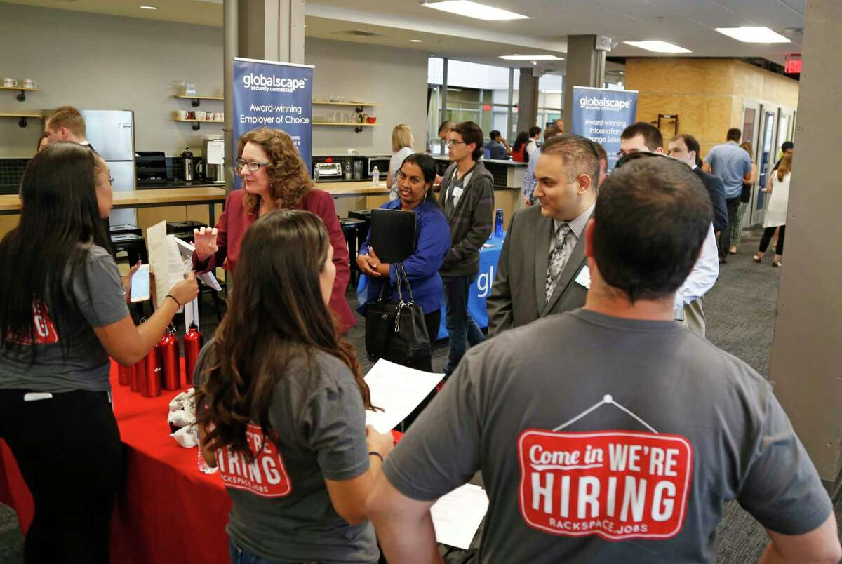 Employees of Rackspace walk to talk to job seekers as Geekdom hosts its second-annual job fair for people seeking jobs with area tech companies. More than 30 employers including Accenture, CPS Energy, Robert Half Technology, Parlevel Systems, HVHC, Inc., and Globalscape participated on Tuesday, September 27, 2016.