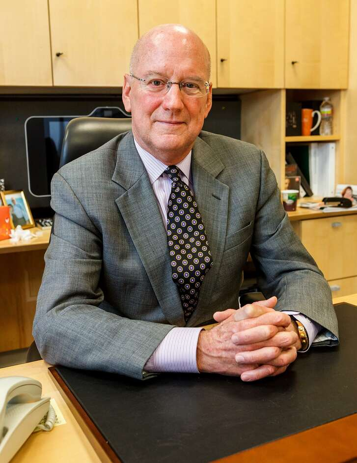 File photo of UT Health San Antonio president William L. Henrich. UT Health has received more than $2.3 million from the Max and Minnie Tomerlin Voelcker Fund to study treatments for cancer and heart disease.