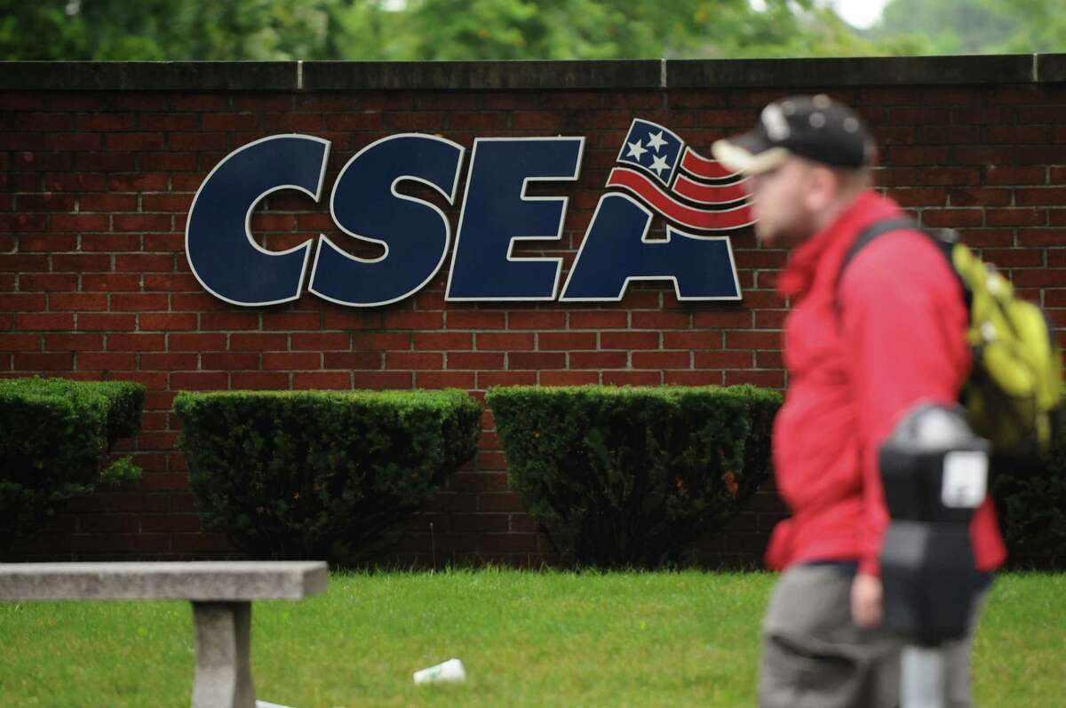 A pedestrian walks past a sign next to the CSEA building on Monday Aug. 15, 2011, in Albany, NY. (Philip Kamrass / Times Union archive)