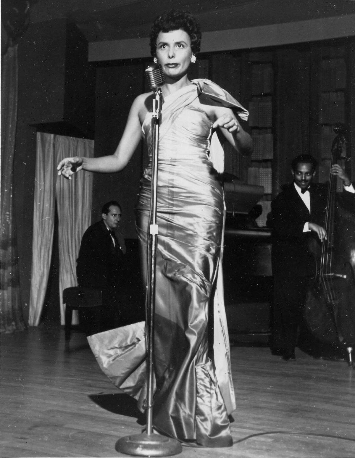 """File -- In a March 1954 file photo singer Lena Horne performs at the Sands Hotel in Las Vegas, Nev. Singer Lena Horne, who broke racial barriers as a Hollywood and Broadway star famed for her velvety rendition of """"Stormy Weather,"""" has died at age 92. (AP Photo)"""