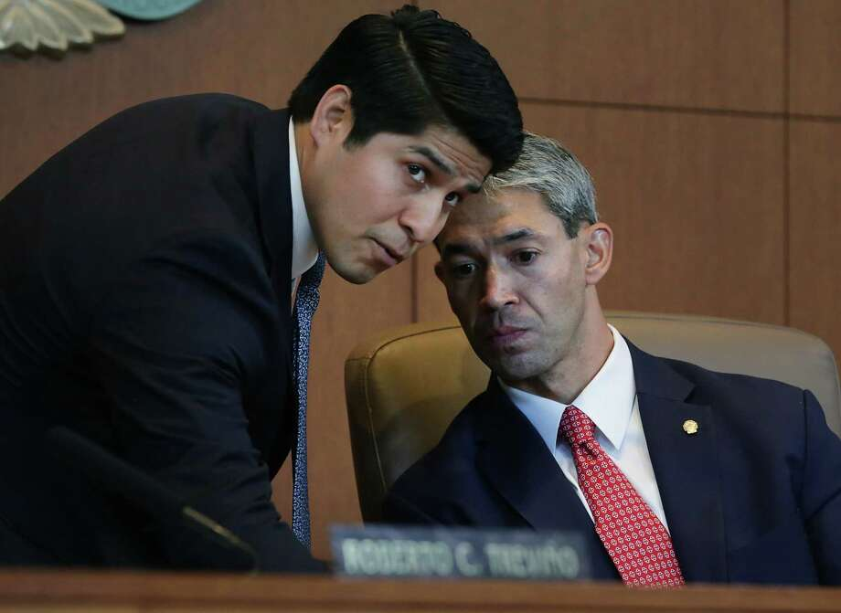 Then-Councilman Rey Sandaña, left, chats with Mayor Ron Nirenberg in this June 21, 2017, photo. With Nirenberg's support, Sandaña got the city to kick in an extra $10 million for VIA. His reputation for being a high-energy fighter for low-income San Antonians who need more reliable bus service is one of the reasons he landed his new job. Photo: Bob Owen, San Antonio Express-News / ©2017 San Antonio Express-News