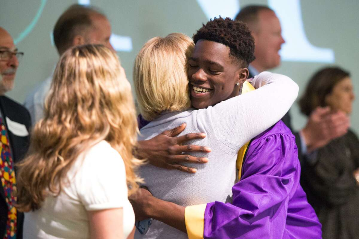 Narold Champagne gives a hug after receiving his scholarship during the 19th Annual Norwalk Housing Foundation Scholarship Awards Ceremony at Stepping Stones Museum for Children in Norwalk on Tuesday, June 20.