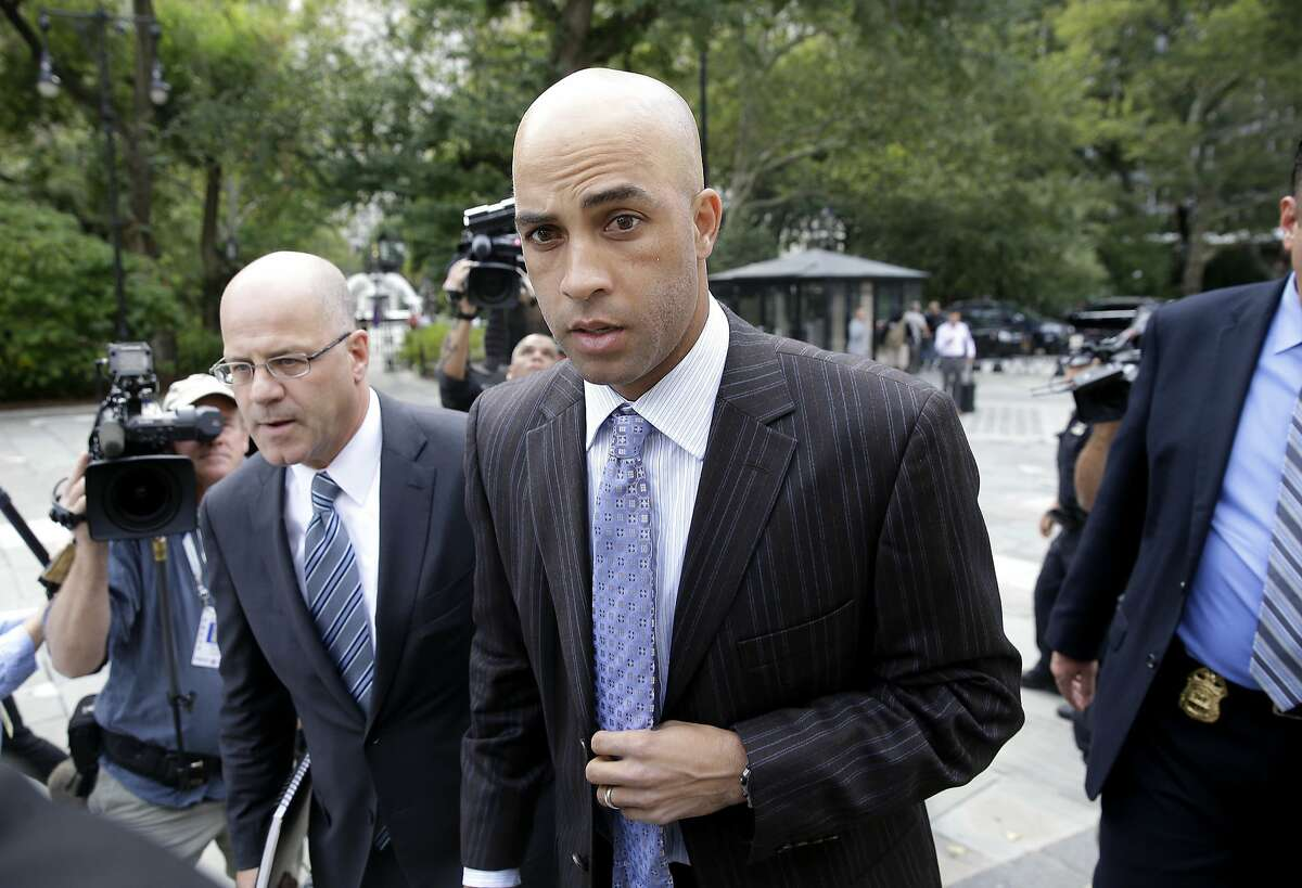 FILE - In this Sept. 21, 2015, file photo, James Blake arrives at New York's City Hall. The former pro tennis player has agreed to drop his right to sue the city after he was mistakenly arrested and tackled by police outside a Manhattan hotel Sept. 9, 2015. Instead the city has agreed to create a legal fellowship in his name that will bolster the work of the city's police watchdog agency. The city and Blake's attorney announced the agreement Wednesday, June 21, 2017.(AP Photo/Seth Wenig, File)