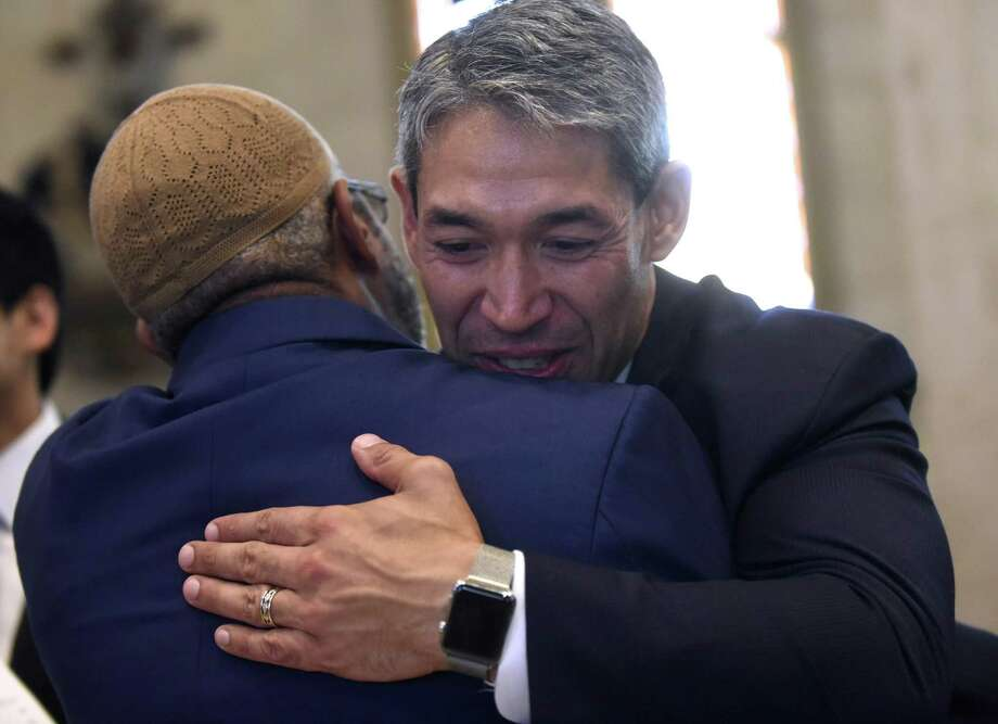 Omar Shakir of Masjid Bilal embraces Mayor Ron Nirenberg this month at San Fernando Cathedral, where the new City Council received blessings from many of the city's religious leaders. Photo: Billy Calzada /San Antonio Express-News / San Antonio Express-News