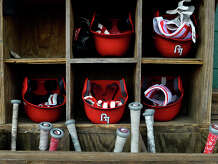 Batting helmets and bats in the dugout during Lamar's first baseball practice on Friday.  Photo taken Friday 1/27/17 Ryan Pelham/The Enterprise