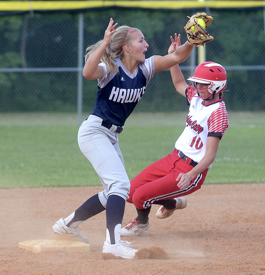 Hardin - Jefferson's Caroline Spacek tries for the out as Bridge City's Kassidy Wilbur slides into second ahead of the throw during their first game of the regional quarterfinal playoffs at Port Arthur Memorial Wednesday. Photo taken Wednesday, May 10, 2017 Kim Brent/The Enterprise Photo: Kim Brent / BEN