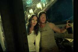 """This image released by Paramount Pictures shows  Laura Haddock as Viviane, left, and Mark Wahlberg as Cade Yeager in a scene from, """"Transformers: The Last Knight."""" (Paramount Pictures/Bay Films via AP) ORG XMIT: NYET155"""