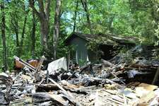 Only an ashen pile of debris remains of a four-bedroom Christian Street home that burned down in the early hours of June 21, 2017.